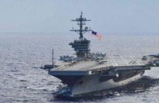Десятки военных на авианосце ВМС США оказались заражены коронавирусом